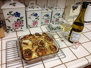 Delicious! My favorite recipe from Cooking Light, Onion Bread Pudding with a nice Chardonnay