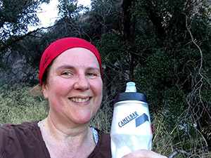 Laurie enjoys refreshing water at the top of the hiking trail.