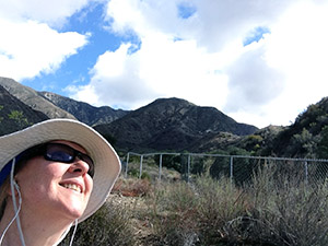 Laurie evaluates the storm clouds before hiking
