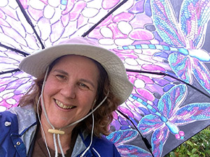 Laurie tries out her new Dragonfly umbrella in an unexpected California rain storm.