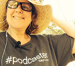 Laurie wears her Podcaster Shirt from the NMX conference