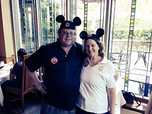 Mark and Laurie wearing Mickey Mouse ears at the Napa Rose Restaurant.