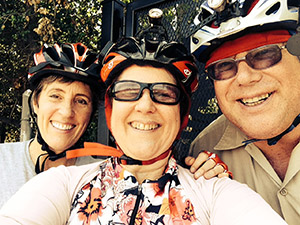 Close-up of Sandy, Laurie and Mark in bike helmets