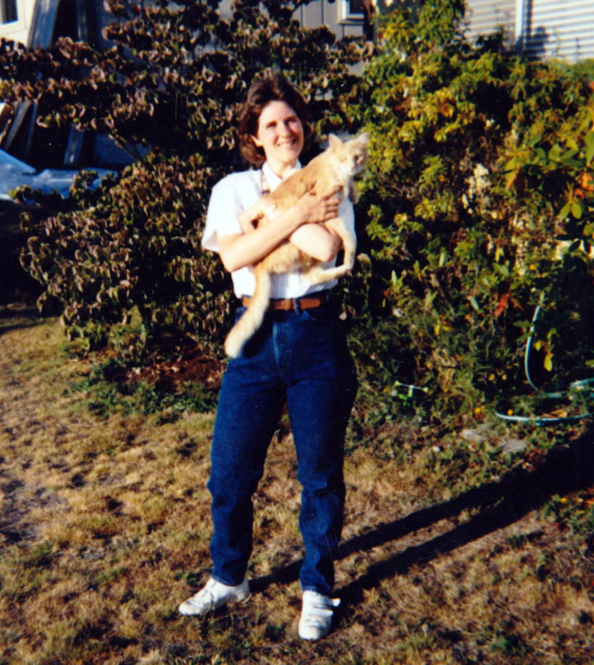 Laurie at 30 holding a cat and looking slim.