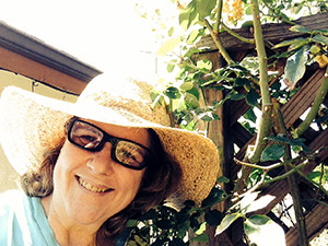 Laurie by a rose trellis.