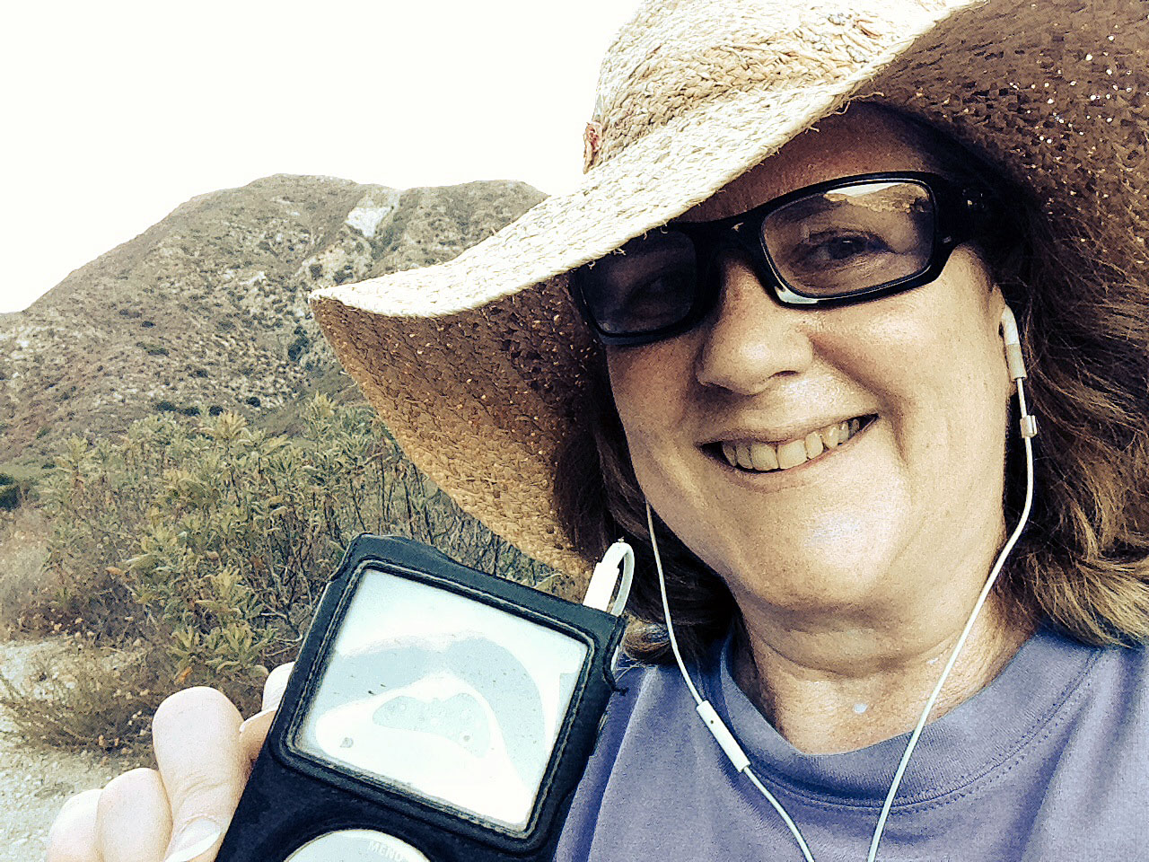 Laurie with her iPod hiking