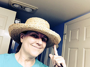 Laurie in a straw boater hat