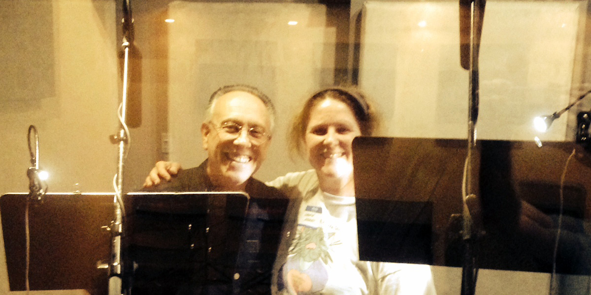 Laurie with Marc Cashman in a sound booth