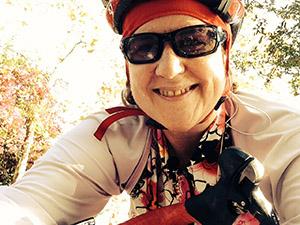 Laurie in bike gear on her bike