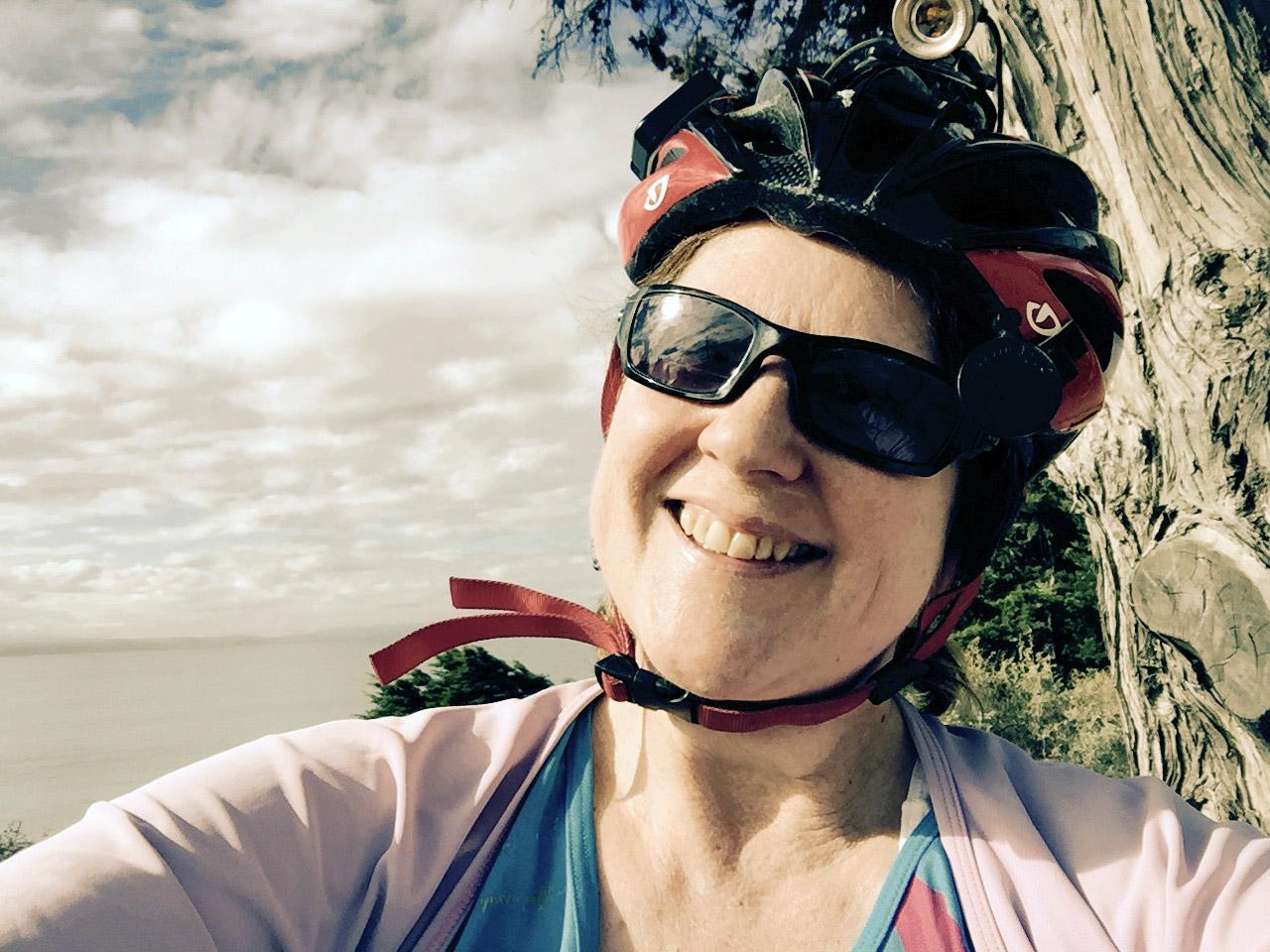 Laurie in bike gear near the sea