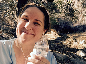 Laurie holding a water bottle at the park