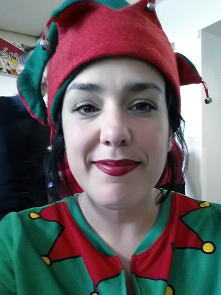 Stéfanie from Quebec in a red and green elf outfit