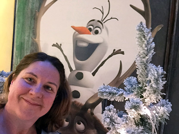 Laurie in front of the character, Olaf from Frozen