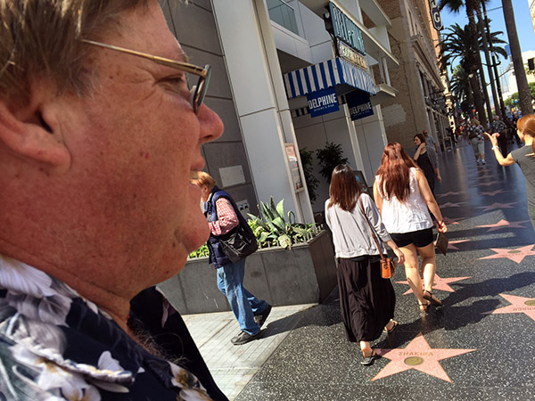 Mark in profile looking at the walk of fame