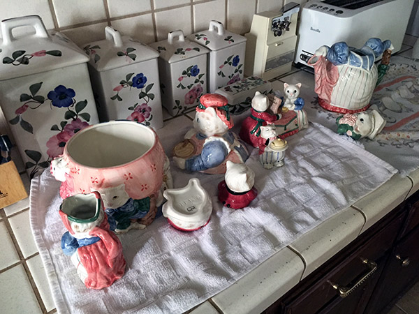 China cats laid out on a towel on the kitchen counter