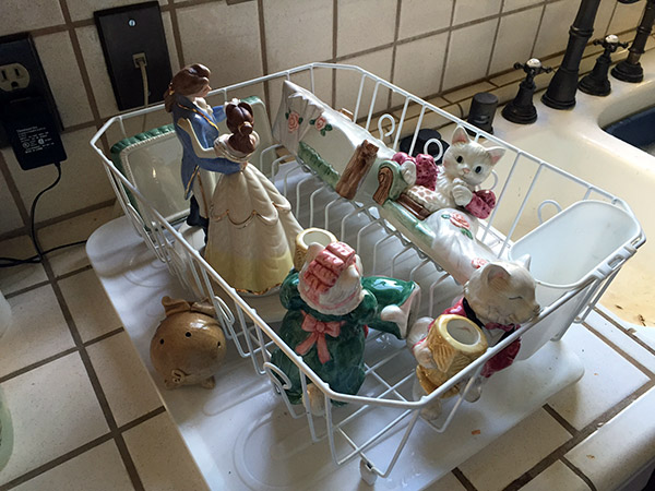 China cats in a dish drainer