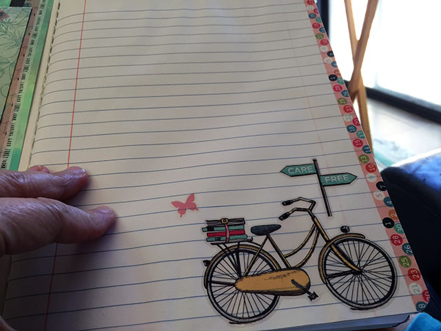 Yellow beach cruiser sticker with school books and butterflies is on the corner of care and free on this journal lower corner.
