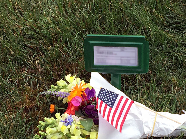 Flowers on the grave for Mom along with a small American flag to honor my dad's military service