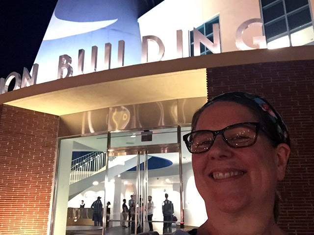 Laurie smiles in front of the Disney Animation Building