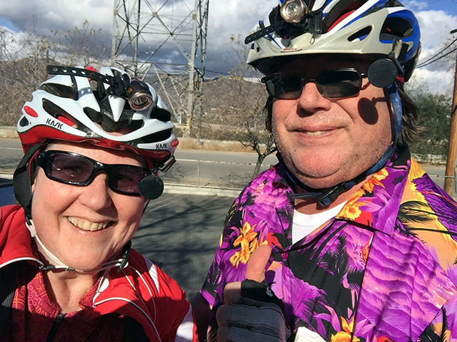 Laurie and Mark in bike helmets - Mark is in his signature purple Hawaiian shirt