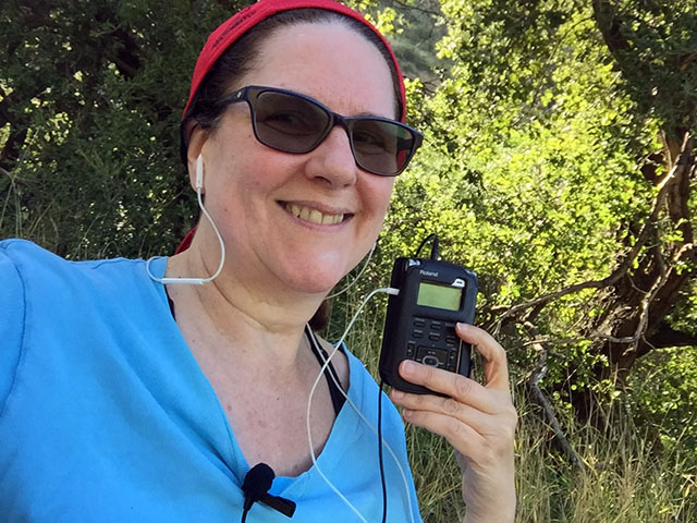Laurie holds a Roland recorder under a tree
