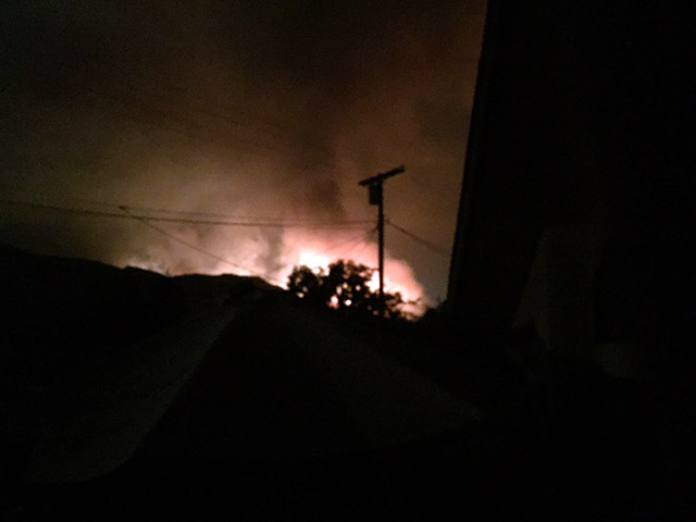Flames in the nearby mountains at night