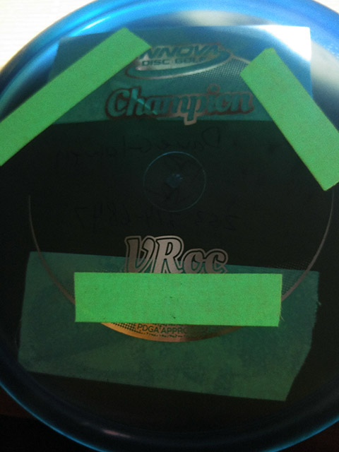 A Close up of the glow in the dark disc used at night for Disc Golf